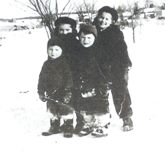 I believe the above picture of the four of us was taken somewhere by the MacCormack house.  Marjorie and Katharine are standing behind me and Johnny.  Smiles all around!