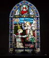 A stained glass window, typical of what would be seen in St. Raphael's Church