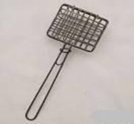 A wire soap shaker from the 1950s.  A cake of soap would be put in the wire basket, then swished in the dishpan to make soap suds to wash the dishes