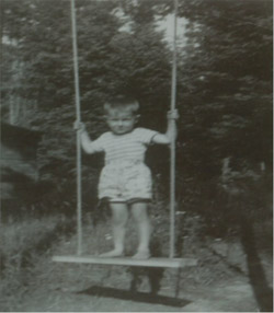 Patty 'the acrobat' on the back yard swing