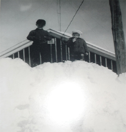 This picture of Leonard and Leslie standing on top of the snow bank in front of our house gives an indication of the amount of snow we got that year.  Note that the house is still unfinished, with just tarpaper strapped to the outside.  Also note the television antenna sticking up from the middle of the house, held erect with wires strung from the corners.