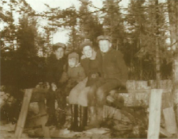 A picture from a few years ago of me and Johnny, with little brother Leonard between us, and friend Alton Underhill, sitting on a sawhorse in our back yard.