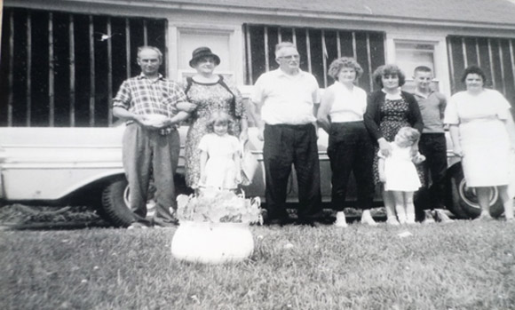 Dad, Granny, Grampa, Mom, Aunt Greta, me, and Aunt Patricia.  The two little girls in front are my little sister Leslie, and Aunt Greta's daughter, Colleen.  Note the chamber pot that Dad's holding in his hands.  He went and got the pot to pose with before the picture was taken.  And Granny laughed and laughed!